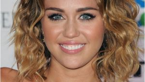 Miley Cyrus Bob Haircut Miley Cyrus Medium Wavy Casual Bob Hairstyle Dark Brunette