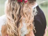 Wedding Hairstyles Half Up with Flowers Red Flower Detail In Wedding Hairstyle with Long Messy Waves