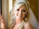 Wedding Hairstyles Half Up with Veil and Tiara Bride with Wavy Hair and Tiara Wedding Hairstyles