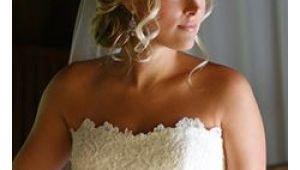 Wedding Hairstyles Strapless Dress Romantic Bridal Hair Low Updo Curls with Veil Hairstyle by Dana
