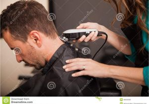 What to ask for when Getting A Haircut Men Getting Haircut at A Salon Stock Image